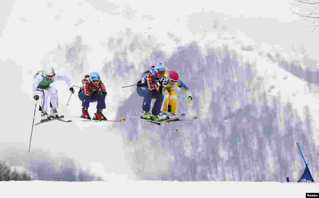 France's Ophelie David, Canada's Kelsey Serwa, Canada's Marielle Thompson and Sweden's Anna Holmlund (L-R) compete during the women's freestyle skiing skicross semi-finals at the 2014 Sochi Winter Olympic Games, Feb. 21, 2014.