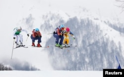 Don't call France's Ophelie David, Canada's Kelsey Serwa, Canada's Marielle Thompson and Sweden's Anna Holmlund (L-R) snow bunnies. They are simply awesome skiiers. Here, they compete at the 2014 Sochi Winter Olympic Games, Feb. 2014. (REUTERS)