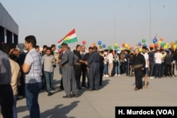 Students gather to protest Baghdad's decision to cancel international flights to and from the Kurdistan Region of Iraq, while mourning families wait for the bodies of their loved ones to return on the last flight from Turkey on Sept. 29, 2017.