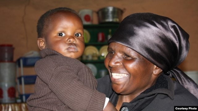 The proud granny with the boy she saved, her grandson, Luphumlo (Photo:D.Taylor)