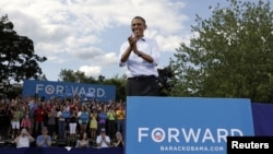U.S. President Barack Obama reacts to supporters during a campaign event in Rochester, New Hampshire, August 18, 2012.