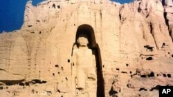 The 53-meter tall, 2,000-year-old Buddha statue located in Bamiyan, about 150 kilometers west of the Afghan capital Kabul, is shown in a November 28, 1997, photo