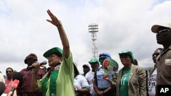 Liberian President Ellen Johnson Sirleaf gestures to supporters as she speaks following a prayer service on the final day of campaigning ahead of presidential elections, in Monrovia, October 9, 2011.
