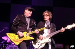 FILE - Rick Nielsen and Tom Petersson of the band Cheap Trick perform in concert at the American Music Theatre in Lancaster, Pa., June 6, 2014.