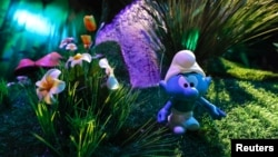 A Smurf characters is seen at the Smurf Experience exhibition, depicting a larger-than-life recreation of the Smurf village, marking the 60th anniversary of the creation of the Smurfs by cartoonist Peyo, in Brussels, Belgium, June 12, 2018.