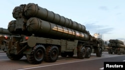 FILE - Russian S-400 air defense mobile missile launching systems take part in a military parade during celebrations marking Independence Day in Minsk, Belarus, July 3, 2014. Russia is deploying a division of S-400 missiles in Crimea.