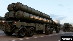 FILE - Russian S-400 air defense mobile missile launching systems take part in a military parade in Minsk, July 3, 2014.
