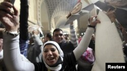 A supporter of deposed Egyptian president Hosni Mubarak celebrates and shouts slogans outside a High Court in Cairo, January 13, 2013.