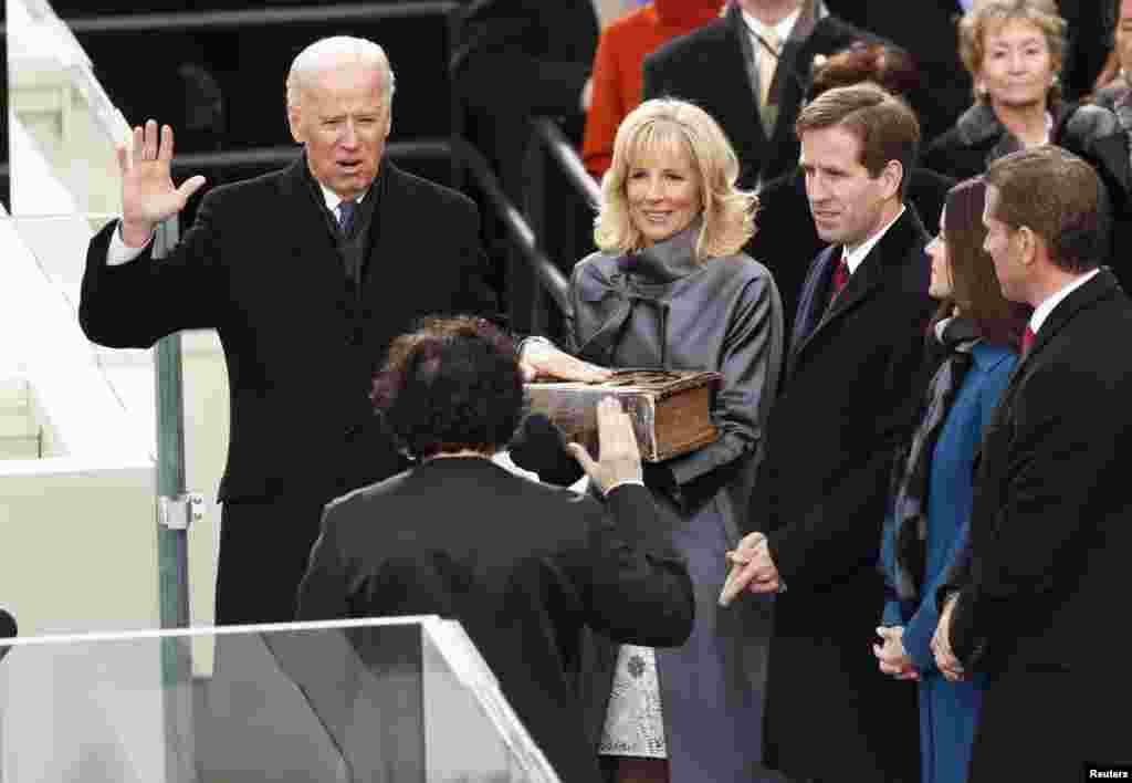Vice President Joe Biden (L) takes the oath from Supreme Court of the US Justice Sonya Sotomayor (2nd L) as Biden's wife Dr. Jill Biden holds the bible during swearing-in ceremonies on the West front of the U.S Capitol in Washington, January 21, 2013