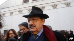 Italian writer Umberto Eco attends the funeral of Italian writer and journalist Giorgio Bocca, at the San Vittore al Corpo church, in Milan, Italy, Tuesday, Dec. 27, 2011. Eco died Friday in Milan at age 84.