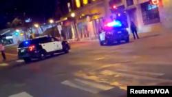 Carros da polícia no local do tiroteio. Minneapolis, 21 de Junho, 2020. Imagem tirada de um vídeo de rede social.