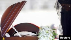 FILE: Former first lady of Zimbabwe, Grace Mugabe pays her last respects during a state funeral of her husband and Zimbabwe's longtime ruler Robert Mugabe, at the national sports stadium in Harare, Zimbabwe, September 14, 2019.
