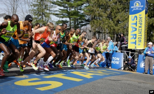 FILE - Elite men runners leave the start line in the 118th running of the Boston Marathon April 21, 2014. Fourth from left is eventual winner Meb Keflizighi