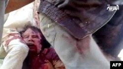 """""""Al-Arabiya"""" telekanali ko'rsatayotgan tasvir. Muammar Qaddafiy ona shahri Sirtada halok bo'lgan."""