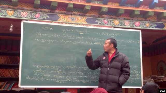 Ngawang Jamyang, a Tibetan monk, age 45, who is said to have died in police custody in China, seen teaching, unknow location, undated.