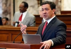 FILE - In this March 7, 2017, photo, state Sen. Chris McDaniel, R-Ellisville, speaks during floor debate in the Senate chambers at the Capitol in Jackson, Miss.