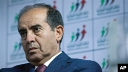 Libyan politician Mahmoud Jibril talks to journalists in Tripoli Aug. 8, 2012.