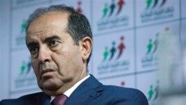 Libyan politician Mahmoud Jibril talks to journalists in Tripoli Aug. 8, 2012.