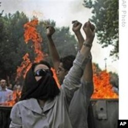 Pink says people, like these Iranian protesters in July 2009, follow a natural instinct to resist control and direct their own lives.