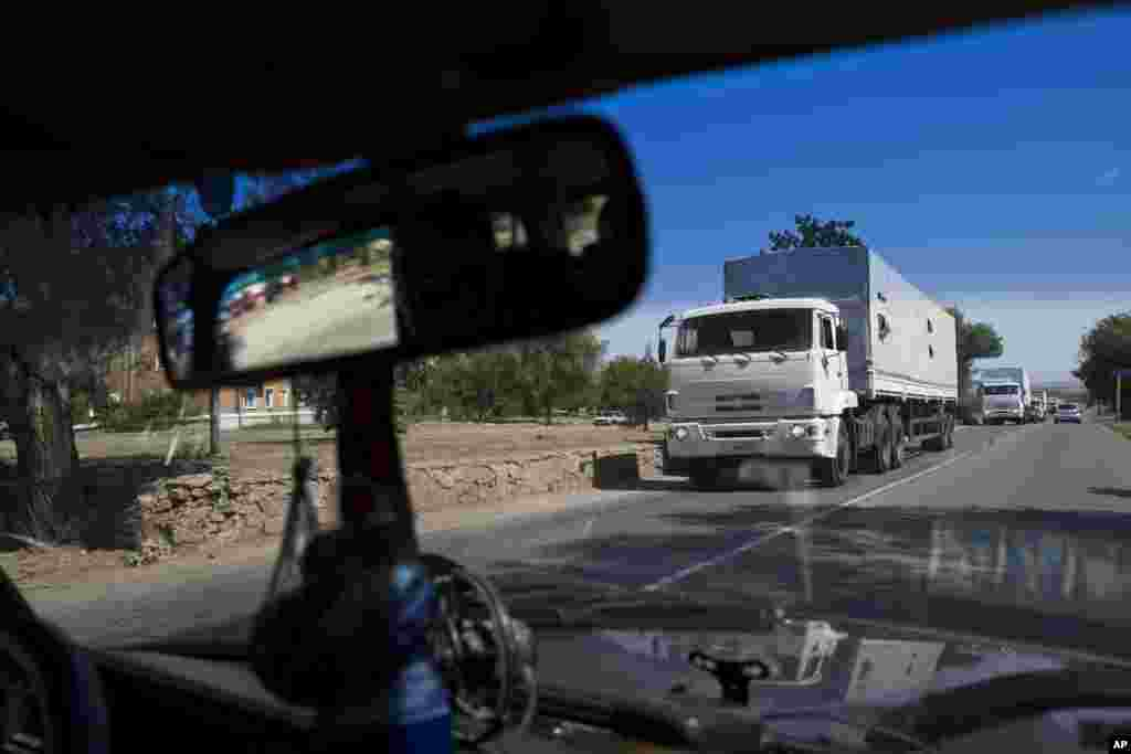 Trucks move toward a border-control point between Russia and Ukraine in the Russian Rostov-on-Don region, near the Donetsk region, Ukraine. The first trucks of the Russian aid convoy crossed the Ukrainian inspection zone Friday morning.