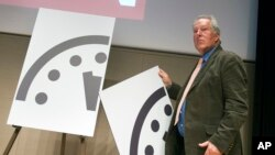 Climate scientist Richard Somerville, a member, Science and Security Board, Bulletin of the Atomic Scientists, unveils the new Doomsday Clock in Washington, Jan. 22, 2015.