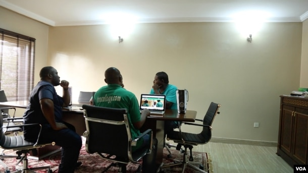 Emma Okene, CEO of Tracology, and his team meet to discuss how to move their startup company forward in Abuja, Nigeria, Sept. 5, 2016. Tracology is a payment management system that uses a barcode to allow users and the government to track utility bill pay