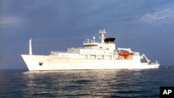 In this undated photo released by the U.S. Navy Visual News Service, the USNS Bowditch, an civilian oceanographic survey ship, sails in open water. The Bowditch was recovering two drones last Thursday when a Chinese navy ship approached and sent out a small boat that took one of the drones, a Pentagon spokesman said.