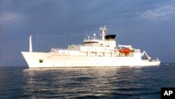 In this undated photo released by the U.S. Navy Visual News Service, the USNS Bowditch, an civilian oceanographic survey ship, sails in open water. The Bowditch was recovering two drones Thursday when a Chinese navy ship approached and sent out a small bo