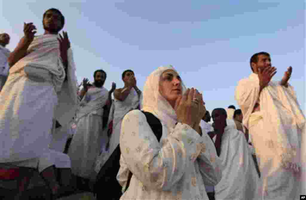 Muslim pilgrims pray on a rocky hill called the Mountain of Mercy, on the Plain of Arafat near Mecca, Saudi Arabia, Monday, Nov. 15, 2010. The annual Islamic pilgrimage draws 2,5 million visitors each year, making it the largest yearly gathering of people
