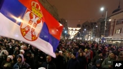 People march during a protest against populist President Aleksandar Vucic in Belgrade, Serbia, Jan. 12, 2019. Critics accuse the president of imposing an autocracy through strict control over the media and promoting hate speech against opponents.