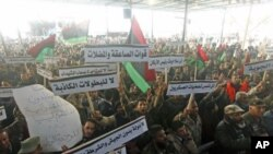 Members of the Libyan National Army rally to call for the National Transitional Council to stop marginalizing the role of the national army in Benghazi, Libya, March 4, 2012.