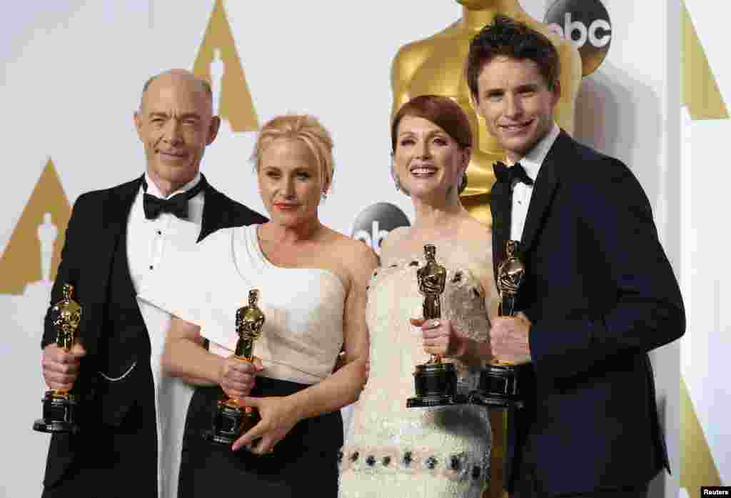 "J.K. Simmons (L), best supporting actor for ""Whiplash, Patricia Arquette (2nd L), best supporting actress for ""Boyhood"", Julianne Moore (3rd L), best actress for ""Still Alice"" and Eddie Redmayne, best actor for ""The Theory of Everything"" pose with their Oscars backstage at the 87th Academy Awards in Hollywood, California, Feb. 22, 2015."