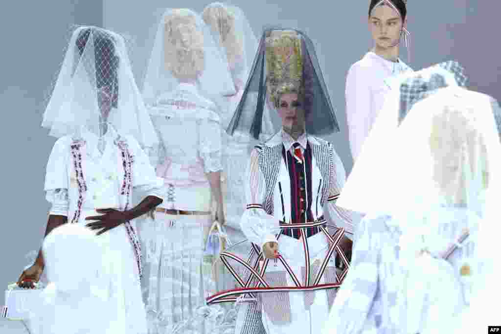 A model presents a creation by Thom Browne during the Women's Spring-Summer 2020 Ready-to-Wear collection fashion show at the Ecole nationale superieure des Beaux-Arts in Paris, France.