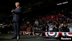 Republican U.S. presidential nominee Donald Trump arrives on stage at a campaign rally in Wilkes-Barre, Pennsylvania, Oct. 10, 2016.