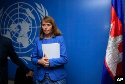 FILE - U.N. Special Rapporteur on Human Rights in Cambodia Rhona Smith attends a press conference at her office in Phnom Penh, Cambodia, Thursday, May 9, 2019. (AP Photo/Heng Sinith)