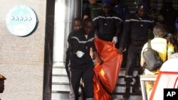 A body is removed from the Radisson Blu hotel, after it was stormed by gunmen during a attack on the hotel in Bamako, Mali, Friday, Nov. 20, 2015. Islamic extremists armed with guns and grenades stormed the luxury Radisson Blu hotel in Mali's capital Friday morning, and security forces worked to free guests floor by floor. (AP/Harouna Traore)