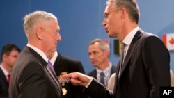 U.S. Defense Secretary Jim Mattis, left, speaks with NATO Secretary General Jens Stoltenberg during a meeting of NATO defense ministers at NATO headquarters in Brussels, June 29, 2017.
