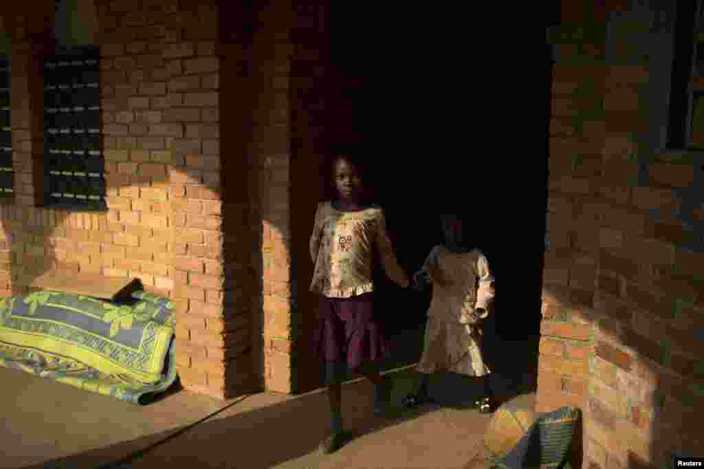 Girls walk in a monastery sheltering internally displaced persons in the district of Boy Rabe in Bangui, Feb. 4, 2014.