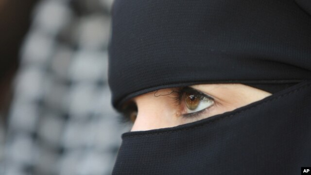 FILE - A 31-year-old French veiled woman, no name released, addresses the media in Nantes, western France, April 23, 2010.