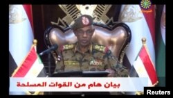 """Sudan's Defense Minister Awad Mohamed Ahmed Ibn Auf makes an announcement in this still image taken from video, April 11, 2019, that President Omar al-Bashir had been detained """"in a safe place"""" and that a military council would run the country for a two-year transitional period."""