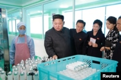 FILE PHOTO: North Korean leader Kim Jong Un and wife Ri Sol Ju visit a cosmetics factory in this undated photo released by North Korea's Korean Central News Agency (KCNA) in Pyongyang on October 28, 2017.
