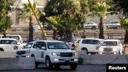 Los inspectores de ONU en momentos de regresar a Damásco tras visitar el área del ataque este lunes 26 de agosto.