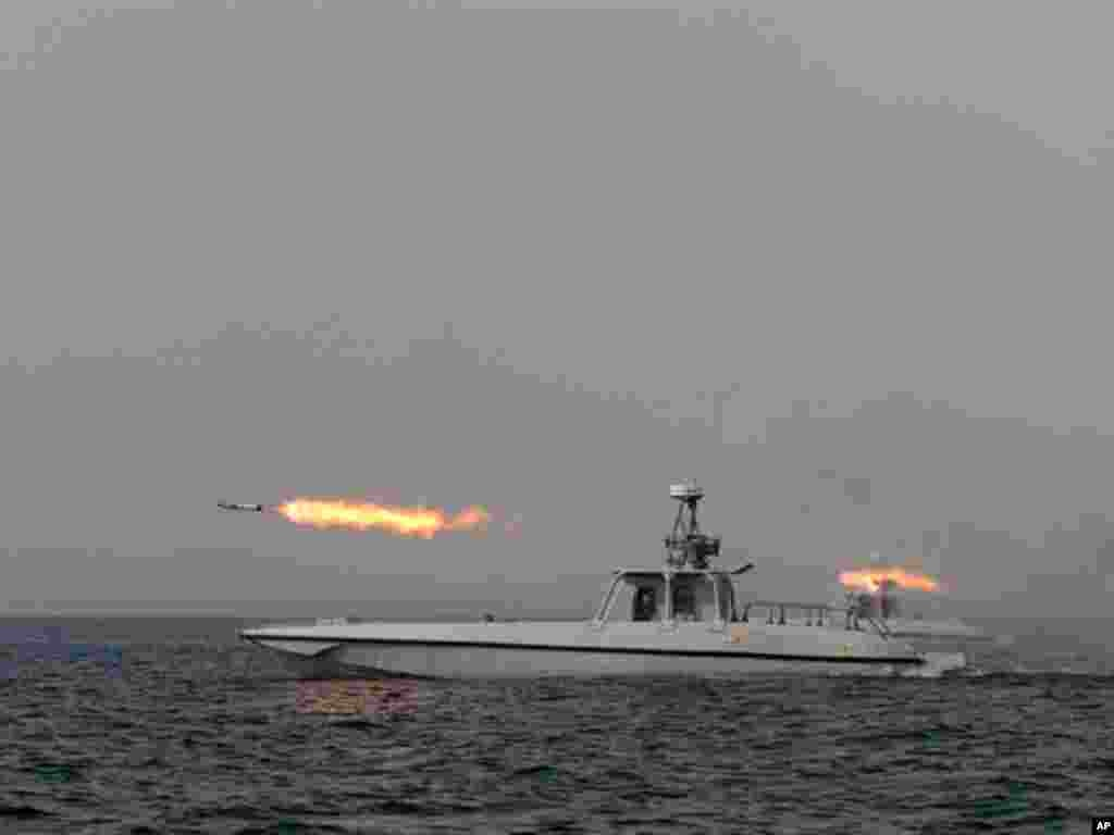 An Iranian navy boat fires a missile in a drill on December 30, 2011. (AP)