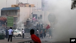 Riot police fire tear gas to prevent Bahraini anti-government protesters from marching toward the hub of last spring's pro-democracy uprising at the end of a mass rally just outside Manama, April 20, 2012.