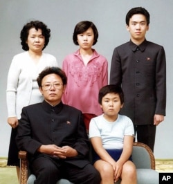 FILE - North Korean leader Kim Jong Il, front left, poses with his first-born son Kim Jong Nam, front right, and his relatives in Pyongyang in this Aug. 19, 1981 photo.