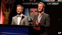 Actors Aaron Paul, left, and Neil Patrick Harris announce nominations at the 65th Primetime Emmy Nominations Announcements, Jul. 18, 2013, in North Hollywood, California.