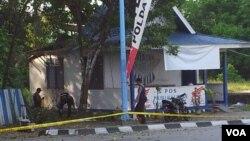 Ledakan bom yang merusak pos polisi lalu lintas di Poso, Sulawesi Tengah. (VOA/Y. Litha)