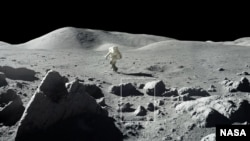 """The surface of the moon is covered with craters and rocks that create a surface """"roughness"""" that casts shadows, as seen in this photograph from NASA's 1972 Apollo 17 mission. These cold shadows may permit water ice to accumulate as frost even at daytime."""