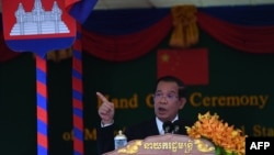 Cambodia's Prime Minister Hun Sen speaks during a handover ceremony of the Morodok Techo National Stadium, funded by China's grant aid under its Belt and Road Initiative, in Phnom Penh on September 12, 2021. (Photo by TANG CHHIN Sothy / POOL / AFP)