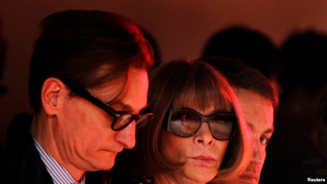 A model is reflected in the glasses of Vogue editor Anna Wintour as she presents a creation from the Creatures of The Wind Autumn/Winter 2013 collection during New York Fashion Week, Feb. 7, 2013.